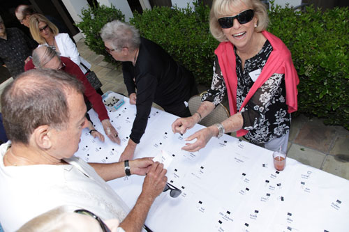 Jan Ambler, Diane Adler at table handing out name tags